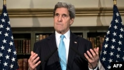 US Secretary of State John Kerry pauses while speaking during a press conference in London on March 14, 2014. Kerry spoke to the press after meeting with Russian Foreign Minister Sergey Lavrov. The United States and Russia failed on March 14 to resolve a