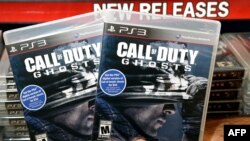 """Store manager Brandon Khan displays copies of """"Call of Duty: Ghosts"""""""
